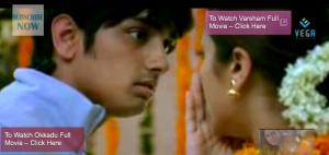 Santosh glares at Siri after she hits/pushes him away.