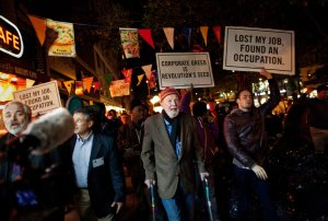 Pete Seeger marching with  Occupy Wall Street protestors, October 2011.